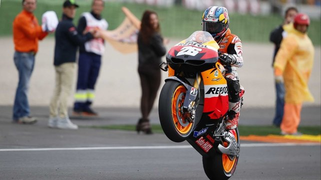 Dani Pedrosa celebrates victory at the Ricardo Tormo racetrack