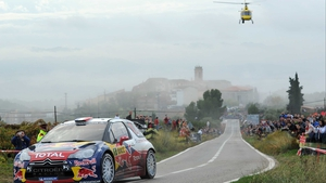 Sebastien Loeb flanked by a helicopter in Salou, Spain