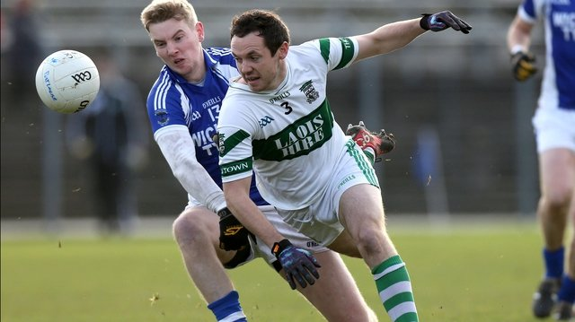 St. Patrick's Tommy Kelly and Brian Mulligan of Portlaoise