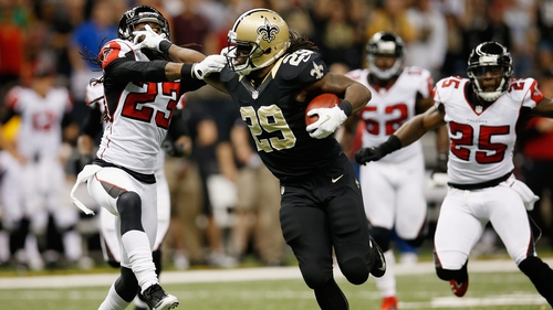 Chris Ivory of the New Orleans Saints hands off Dunta Robinson of the Atlanta Falcons to score a touchdown at the Mercedes-Benz Superdome