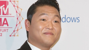 Psy to work with Brian May