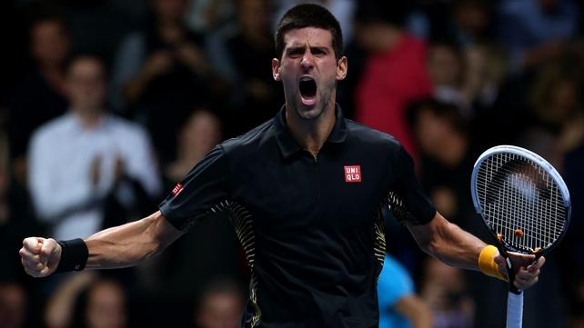 Novak Djokovic celebrates after edging out Roger Federer