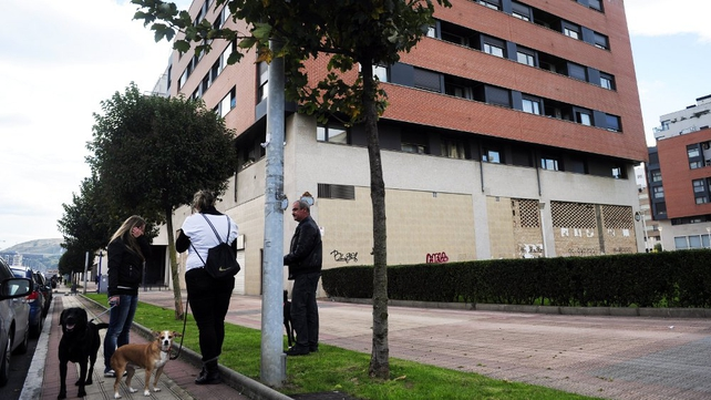 People chat close to the place where Amaia Egana took her own life in Barakaldo
