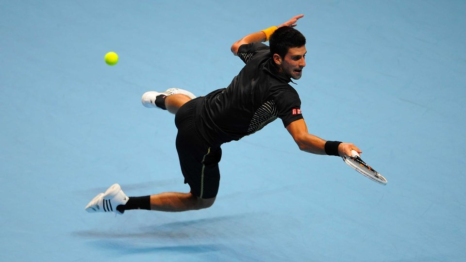 More Spiderman than the Djoker - ATP World Tour Finals champion Novak Djokovic displays his agility at the 02 in London