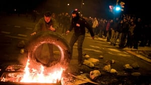 Demonstrators set up a barricade of burning tyres at the main entrance of the Mercabarna market in Barcelona