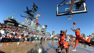 In a special match on the USS Midway, Michael Carter-Williams of Syracuse Orange scores against San Diego State Aztecs