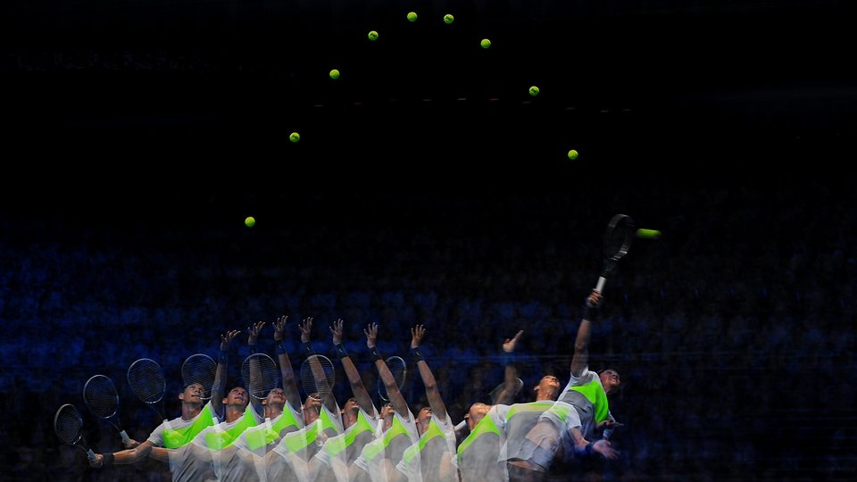At the ATP World Tour finals, Tomas Berdych serves during his men's singles match against Novak Djokovic