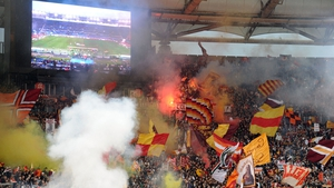 Roma fans play their part during the hotly contested Rome derby against Lazio at the Stadio Olimpico