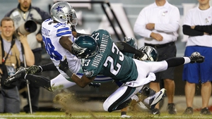 Dez Bryant of the Dallas Cowboys  is taken down after making a catch by Dominique Rodgers-Cromartie of the Philadelphia Eagles
