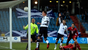 Jordan Rhodes of Scotland heads home the first goal of the game against Luxembourg