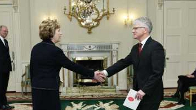Denmark's Ambassador to Ireland Niels Pultz shake hands with former President Mary McAleese
