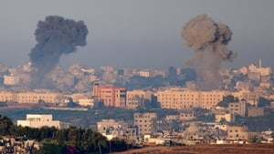 Plumes of smoke rise over Gaza during an Israeli air strike