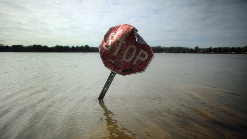 Flood waters surround a stop sign in Bay Head, New Jersey. Many residents of the seaside town remain without power following Superstorm Sandy