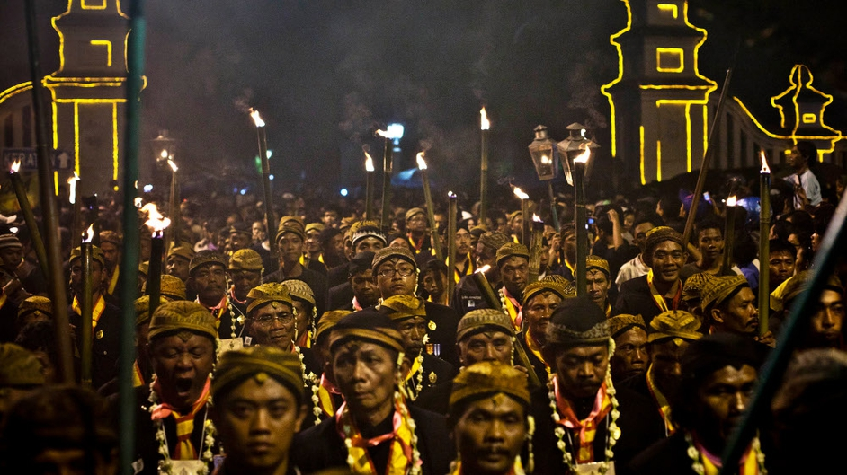 Javanese people walk on the rituals night carnival '1st Suro' (Javanese calendar) during Islamic New Year celebrations at Kasunanan Palace in Solo City, Central Java, Indonesia