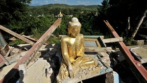 A buddha statue is seen among the debris in a destroyed monastery after a 6.8-magnitude earthquake in Thabeikkyin Township, Mandalay division of Burma
