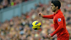 Suarez helped himself to two goals as Liverpool beat Wigan for the first time in three years