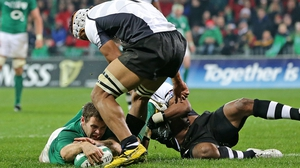 Darren Cave stretches for Ireland's fourth try after a zig-zag run through the Fiji defence