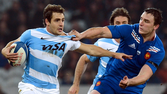 Argentina's Federico Sanchez is tackled by France's Louis Picamoles