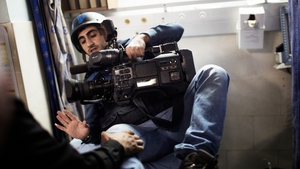 Ajab al-Shorafa, a cameraman for Press TV network, is examined in a Gazan hospital following the strike on the TV station