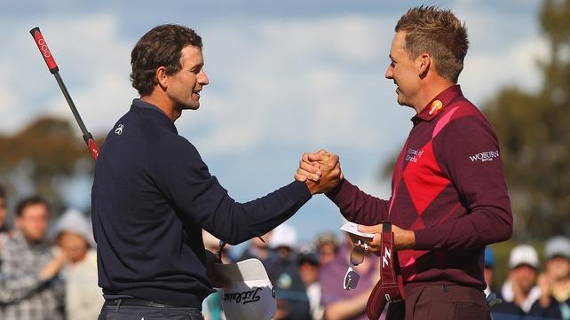 Ian Poulter congratulates tournament winner Adam Scott on the 18th hole