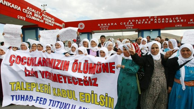 Kurdish women hold a banner reading 'We will not let our children die' as they demonstrate outside a prison in Sincan, near Ankara