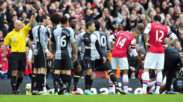 Howard Webb gives Emmanuel Adebayor his marching orders