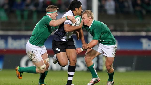 Ravai Fatiaki tackled by Jamie Heaslip and Luke Marshall during Ireland's 53-0 victory
