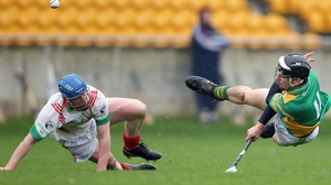 Kilcormac-Killoughey's Conor Mahon (R) and Pat Mahon of Rathdowney Erril during the Leinster hurling club semi-final