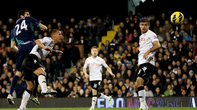 Carlos Cuellar rises above Steve Sidwell to score Sunderland's second goal