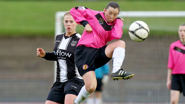 Clare Conlon of Wexford Youths gets to the ball ahead of Mary Waldron