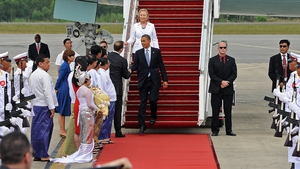Mr Obama shakes hands with Derek Mitchell, the US ambassador to Burma