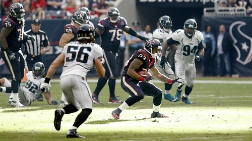 Arian Foster of the Houston Texans gaining some yardage against the Jacksonville Jaguars