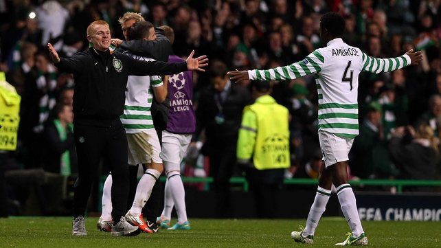 Neil Lennon (L) celebrates Celtic's crucial victory over Barcelona