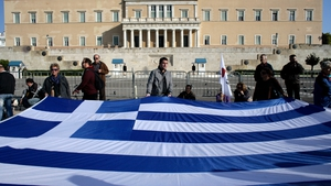 Greek government passed an austerity package worth €13.5bn last week