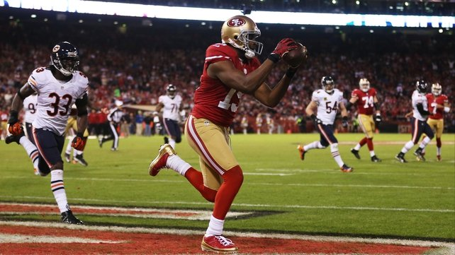 Michael Crabtree catches a third-quarter touchdown as San Francisco 49ers eased past the Chicago Bears at Candlestick Park