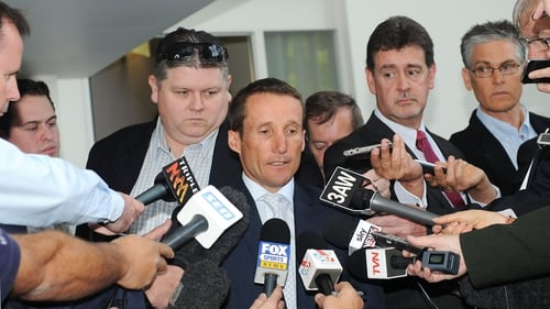 Damien Oliver speaks to reporters after arriving at Racing Victoria headquarters this morning