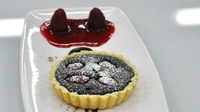 Chocolate and raspberry tart - Served with raspberry jellies, vanilla ice-cream and a pecan crumb