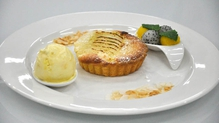 Poached pear and frangipane tart with coconut and mango ice-cream