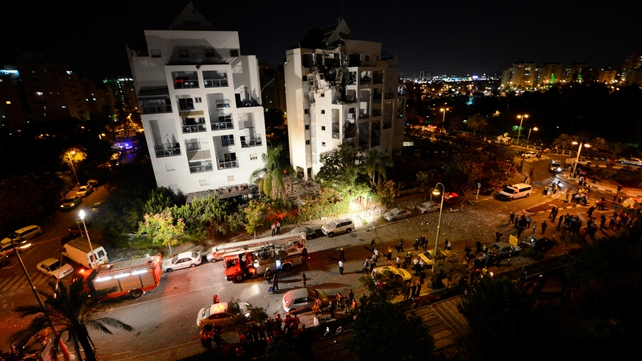 Israeli emergency services inspect a destroyed house that was hit by a rocket, fired from Gaza, in Rishon Letzion, near Tel Aviv