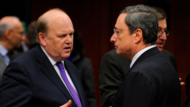 Michael Noonan talks with ECB president Mario Draghi ahead of the meeting