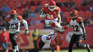 Tony Moeaki of the of the Kansas City Chiefs leaps over defenders at Arrowhead Stadium in Kansas City, Missouri