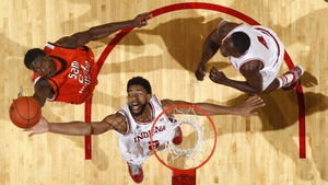 Christian Watford of the Indiana Hoosiers goes for a rebound against Terrance Motley of the Sam Houston State Bearkats