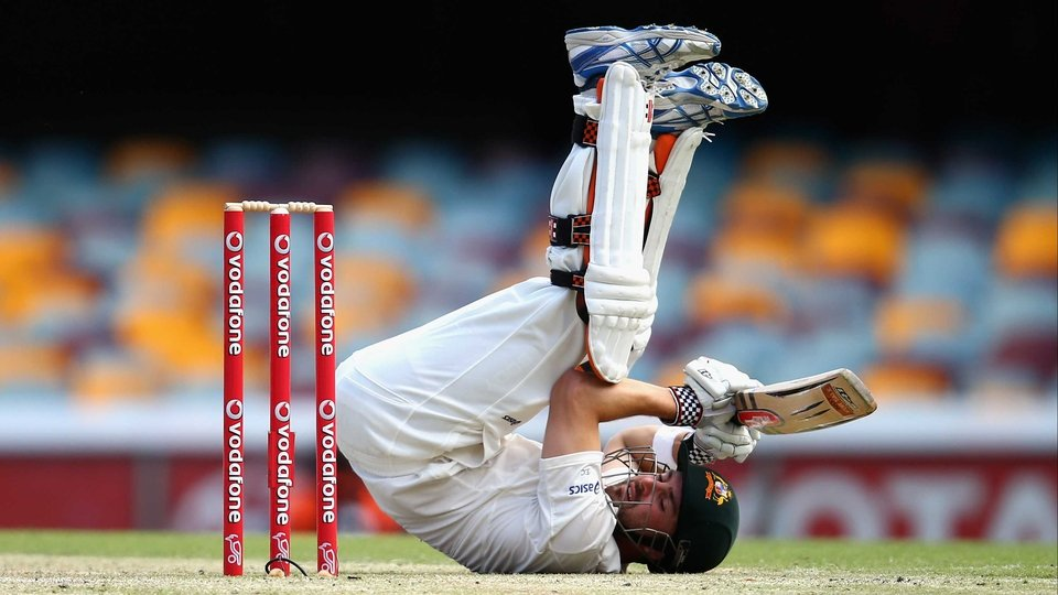 Ed Cowan of Australia loses his footing during day four of the First Test match between Australia and South Africa at The Gabba