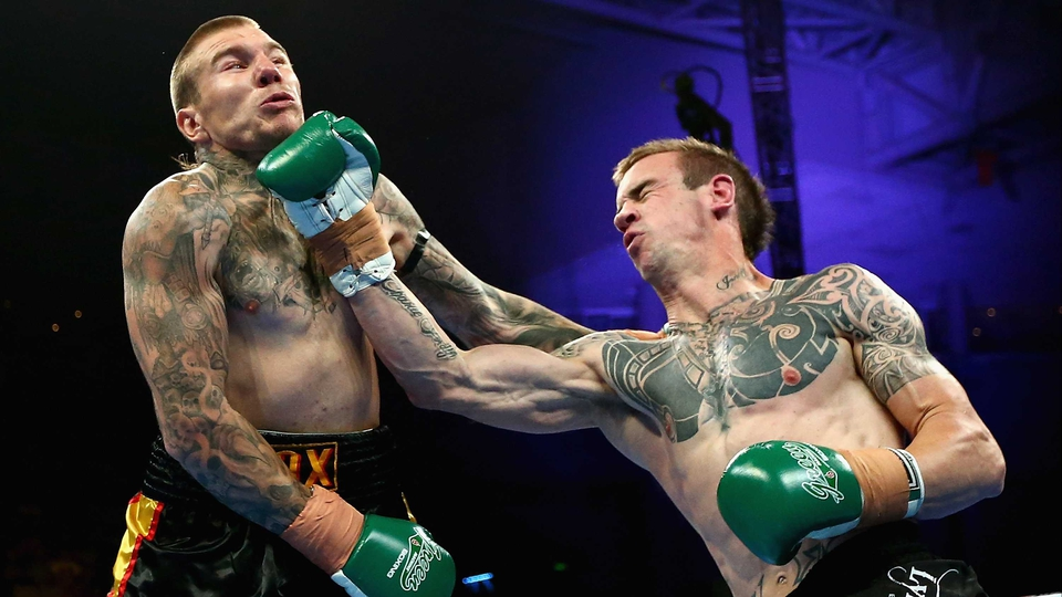 Lyndon Edney lands a punch to the chin of Jeremy Van Diemen in Melbourne, Australia