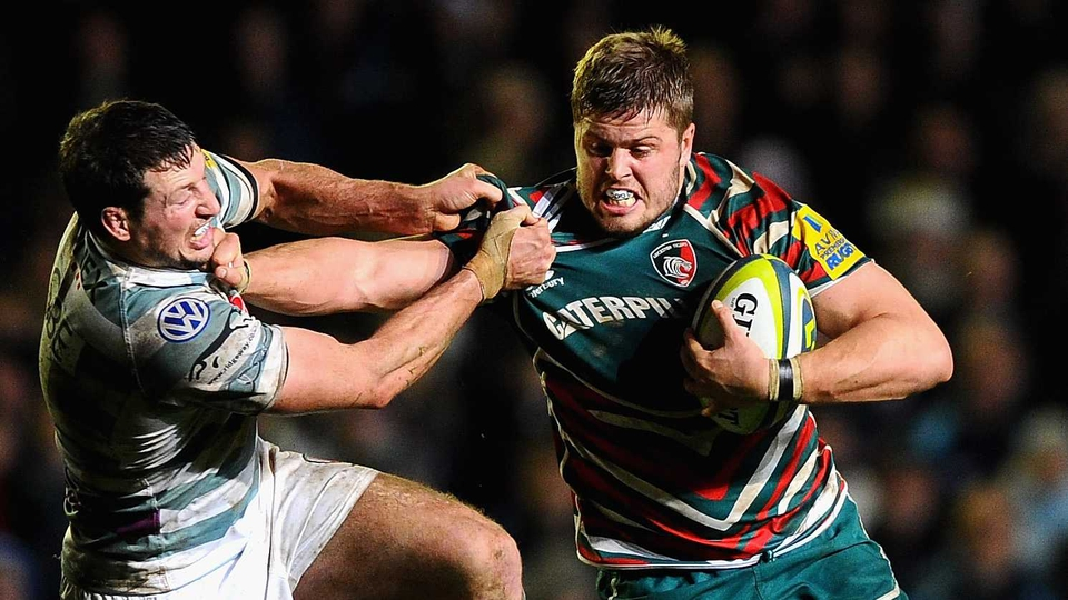 Ed Slater of Leicester Tigers is tackled by Declan Danaher of London Irish during an LV Cup match