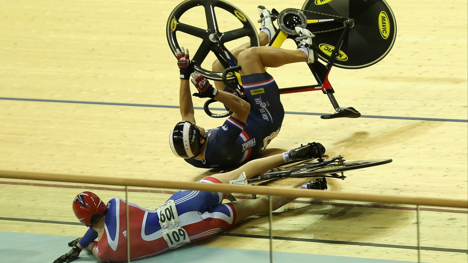 Jason Kenny of Britain crashes out of the Men's Kierin Final on day two of the UCI Track Cycling World Cup