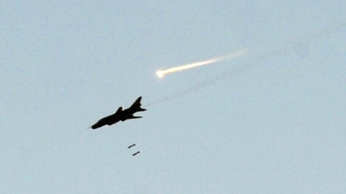 Syrian fighter jets hit the suburb of Daraya