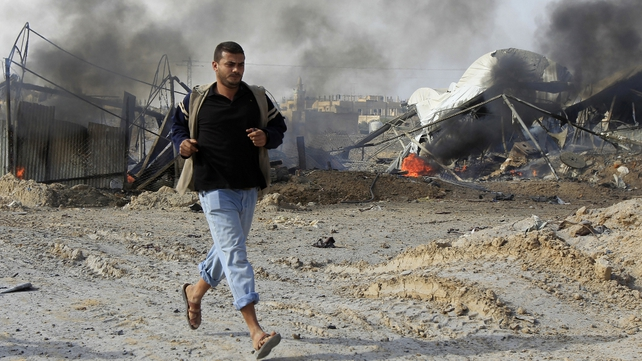A Palestinian man reacts after an Israeli air strike near smuggling tunnels between the southern Gaza Strip and Egypt