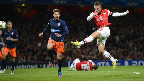 Lukas Podolski unleashed a viscous volley to give Arsenal a two-goal advantage at the Emirates