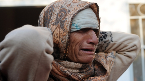 A Pakistani woman mourns the death of a relative following suicide bomb in Rawalpindi